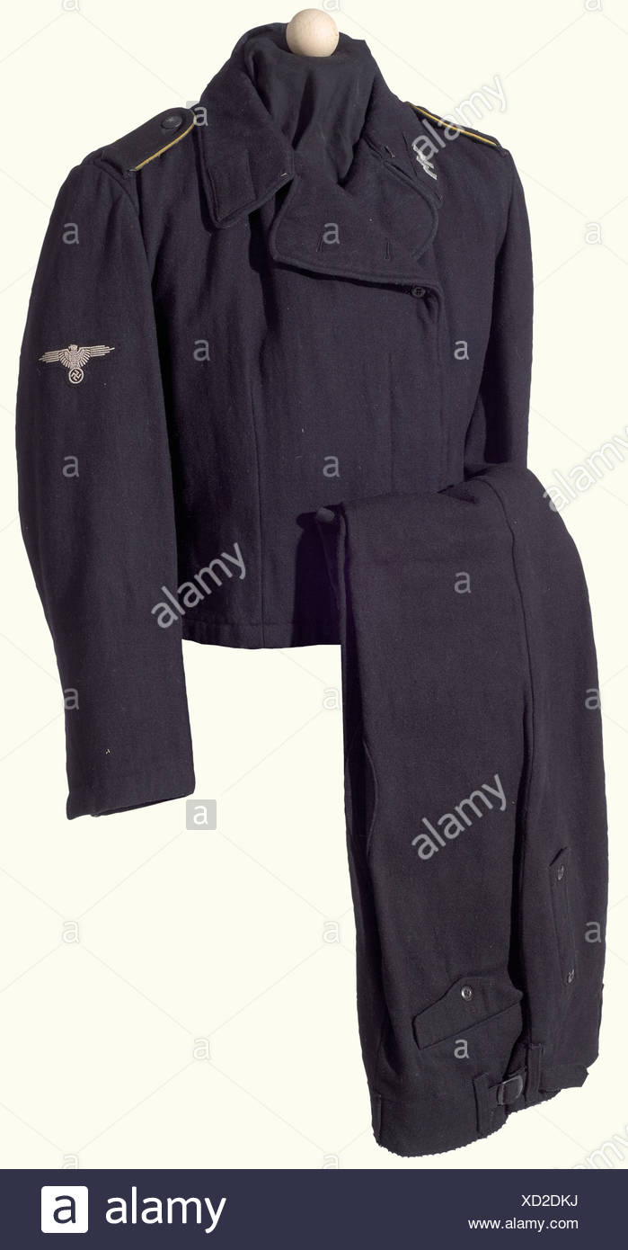 A black Panzer uniform for an enlisted man, of a reconnaissance unit. Field jacket of black wool, grey wool lining with depot and size stampings, resin buttons, looped shoulder boards with yellow piping. Machine embroidered eagle and collar patches. Black woolen breeches with white cotton lining and depot/size stampings, resin buttons. Cleaned in modern times. historic, historical, 1930s, 1930s, 20th century, Waffen-SS, armed division of the SS, armed service, armed services, NS, National Socialism, Nazism, Third Reich, German Reich, Germany, military, militari, Additional-Rights-Clearances-NA - Stock Image
