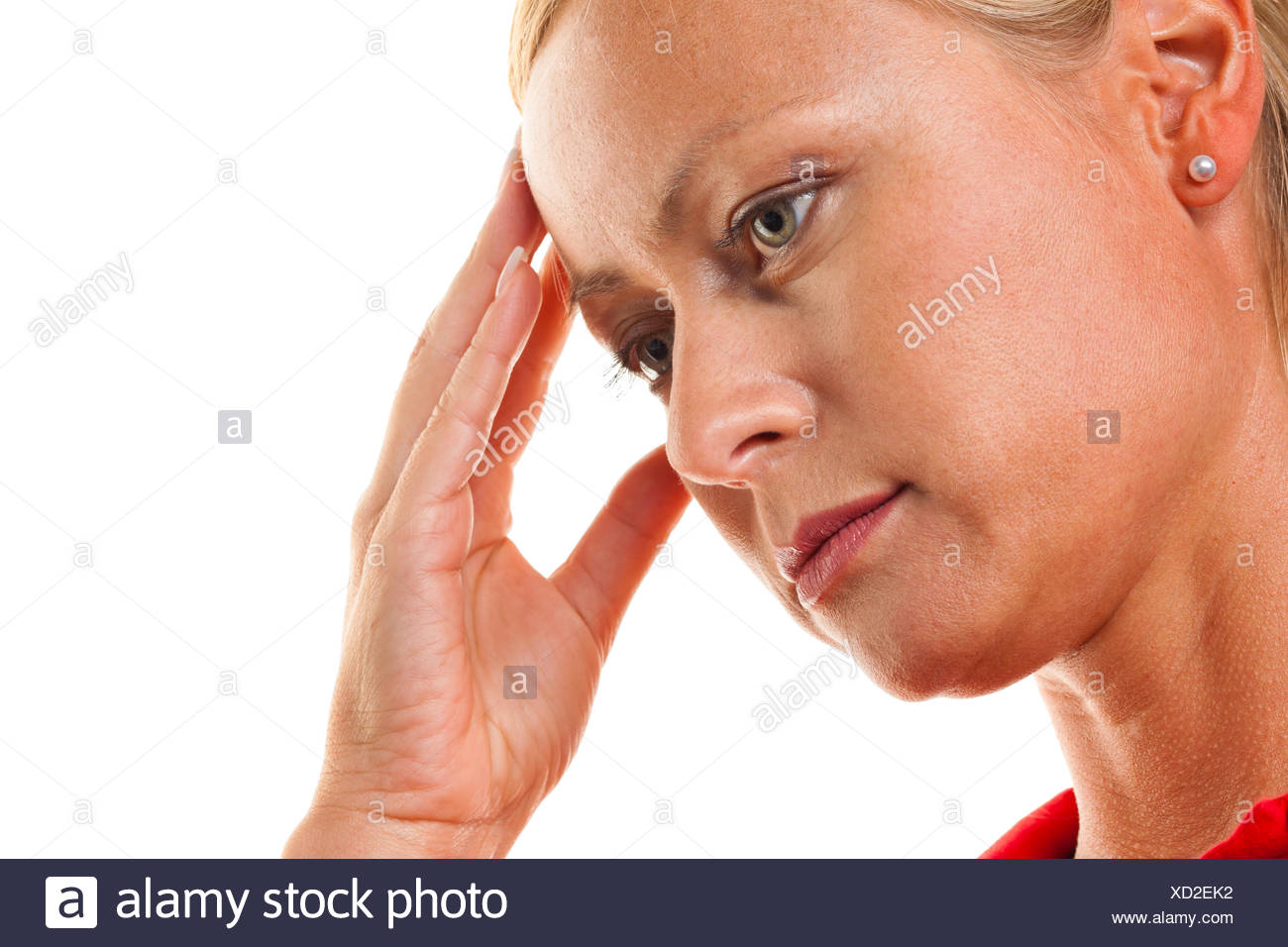 Pensive woman with headaches and migraines. - Stock Image