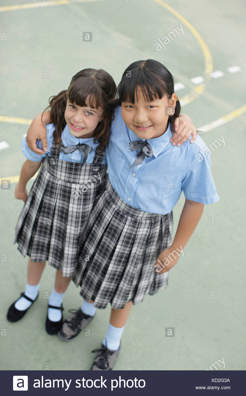 School girls hugging each other - Stock Image