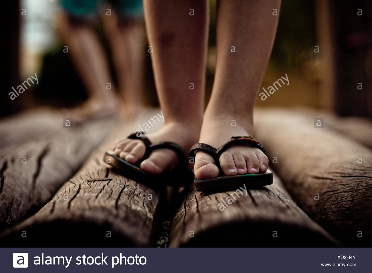 Close up of feet in flip flops Stock Photo