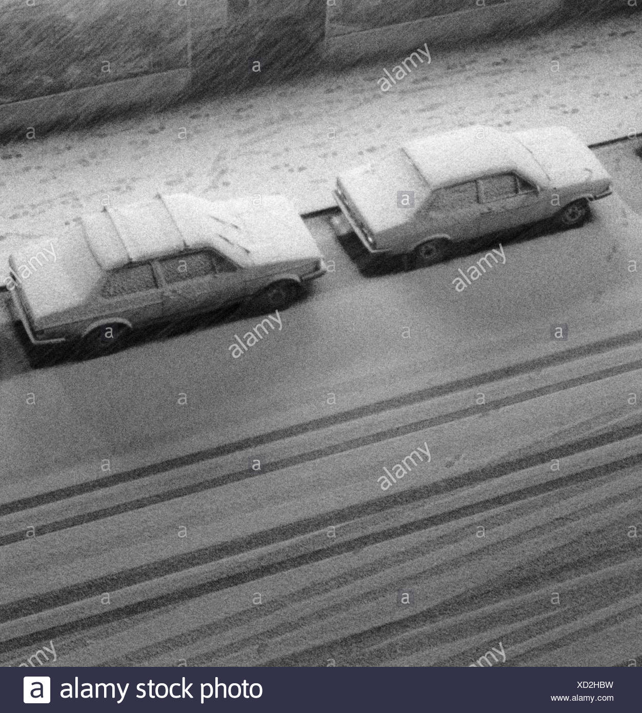 Cars parked outdoors covered with snow - Stock Image
