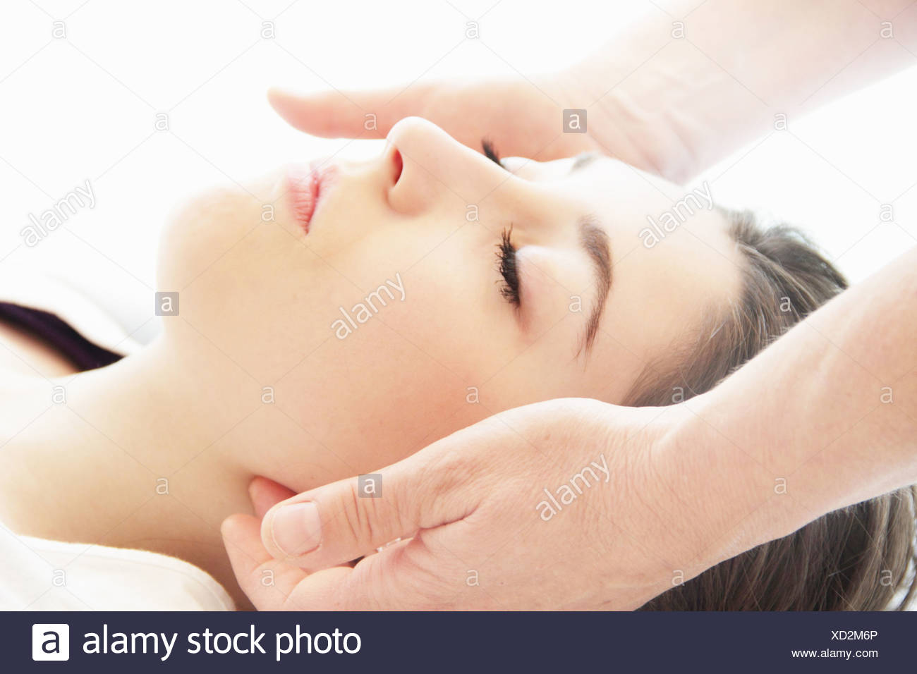 Woman having facial massage in spa Stock Photo