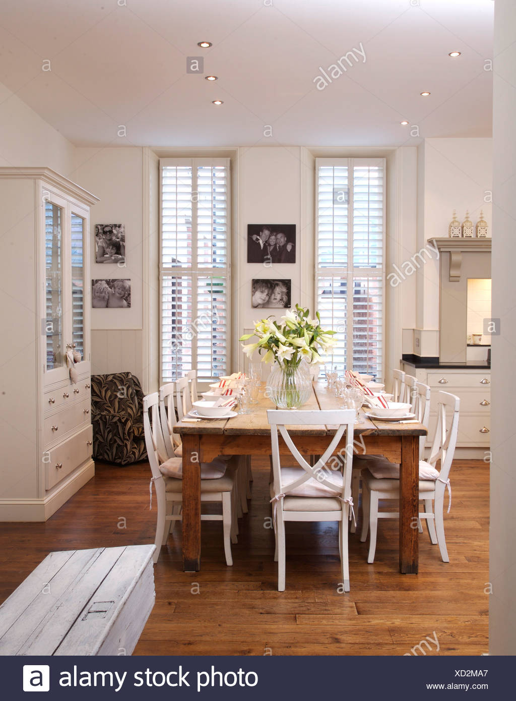 White Chairs At Simple Wood Table In Modern White Kitchen