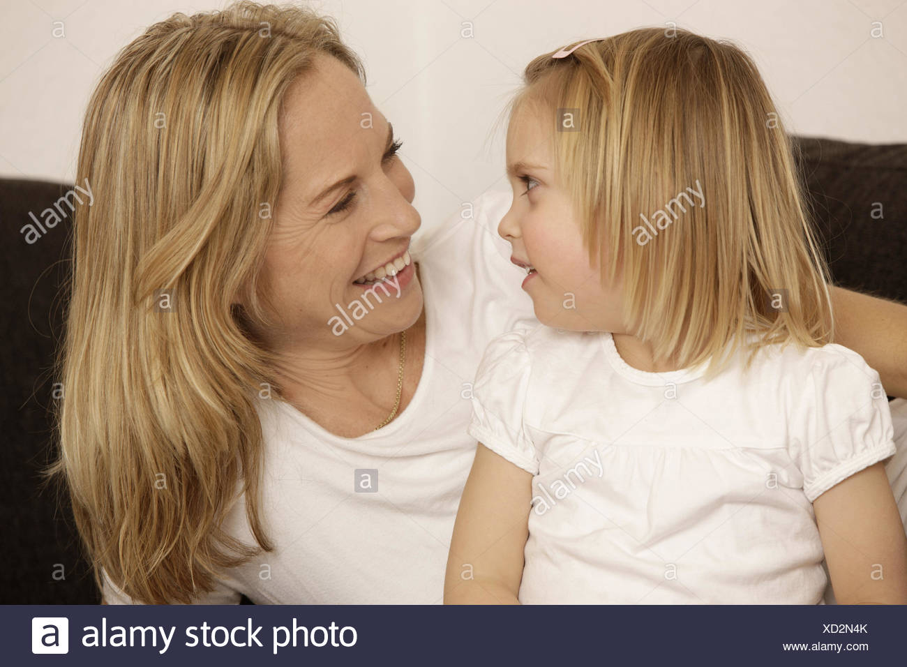 Nut, subsidiary, eye contact, smile, portrait, model released, people, woman, child, girl, blond, side view, suture, affection, happy, motherly love, - Stock Image