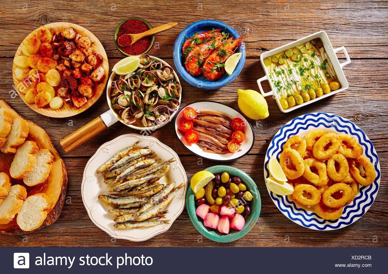 Tapas seafood clams shrimps calamari anchovies shrimps octopus and bread Spain. - Stock Image