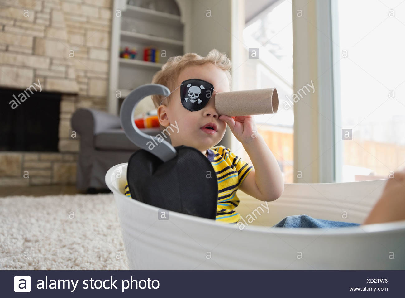 Little boy pretending to be a pirate - Stock Image