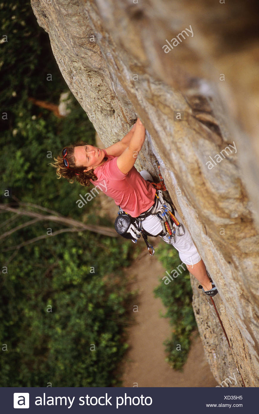 Woman climbing Special Forces, 5.11a. The Fortress. Skaha Bluffs. Penticton, British Columbia, Canada. Stock Photo