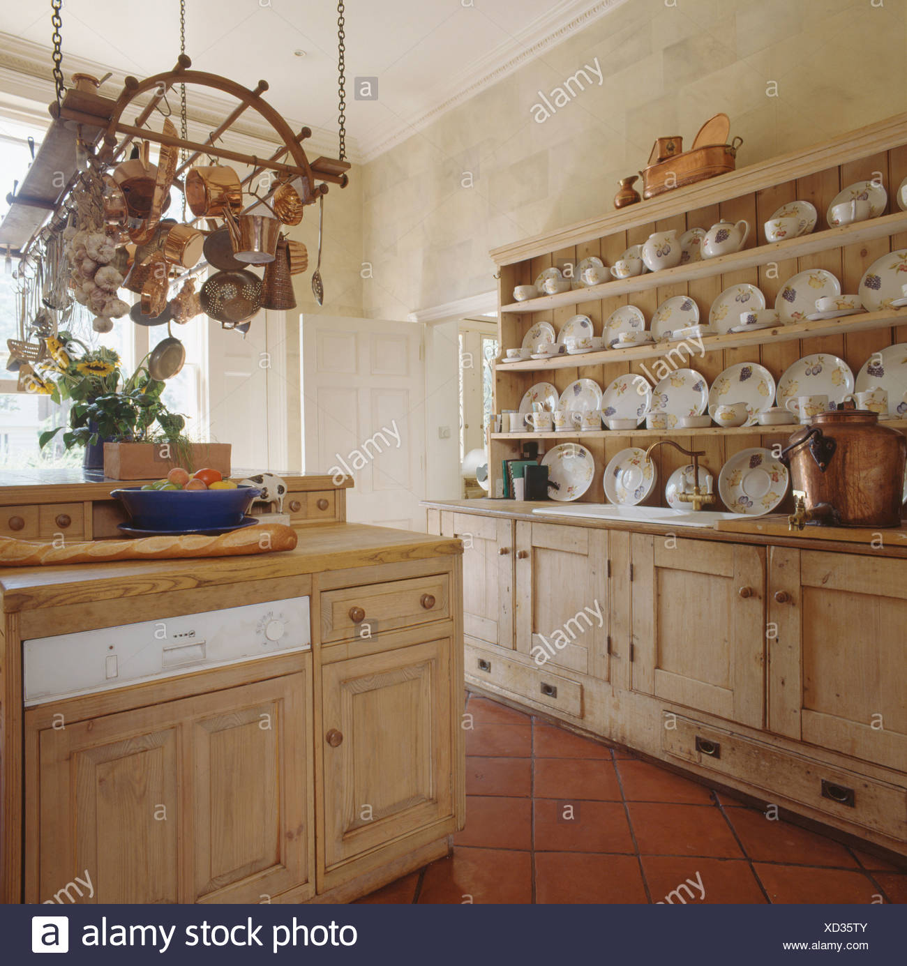 Picture of: Plates On Antique Pine Dresser In Country Kitchen With Saucepans On Rack Above Dishwasher In Fitted Pine Unit Stock Photo Alamy