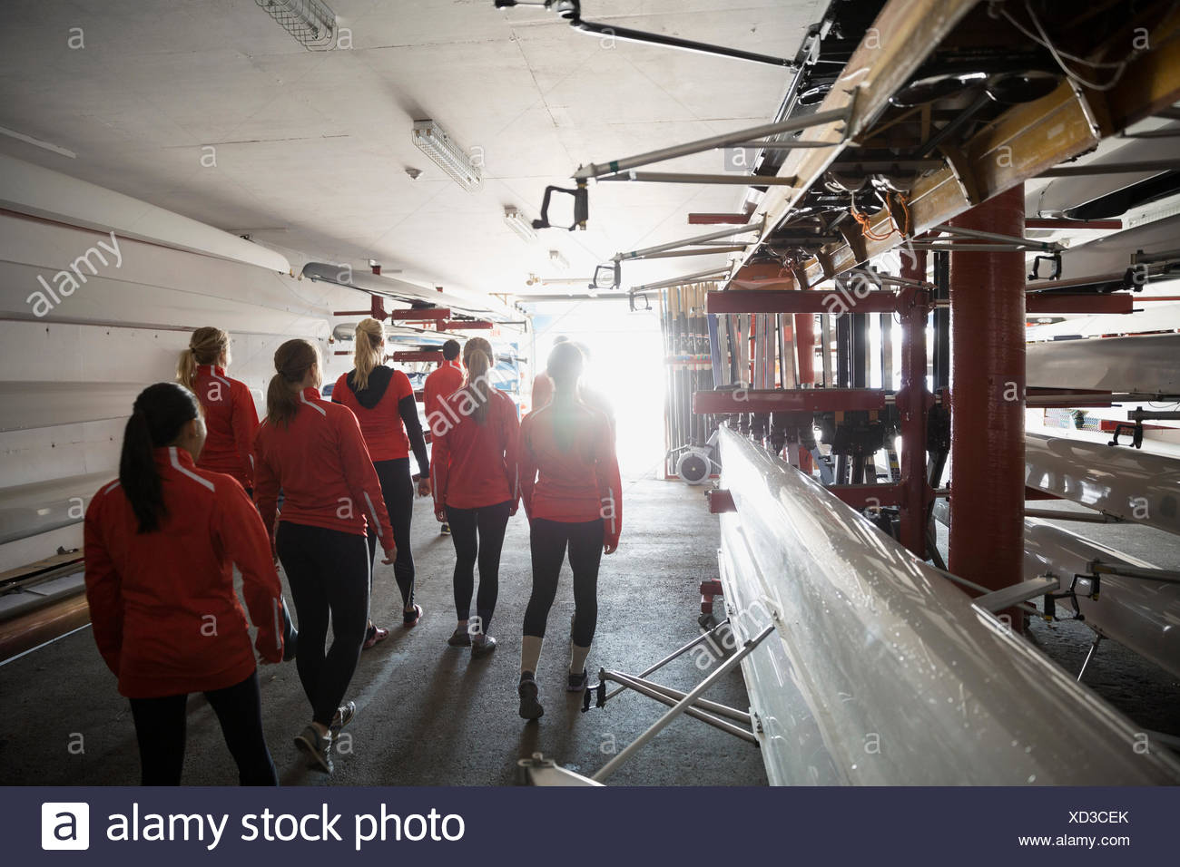 Rowing team in boathouse - Stock Image