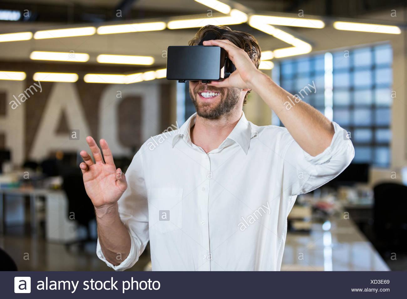 9ad537d383b Businessman wearing virtual reality simulator Stock Photo  283433425 ...
