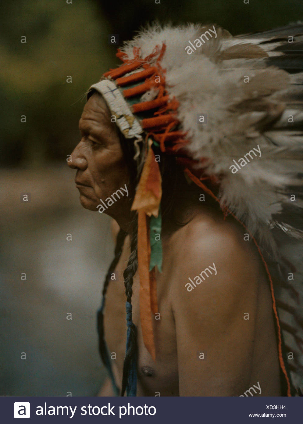 Portrait of a Taos Indian chief with war bonnet. - Stock Image