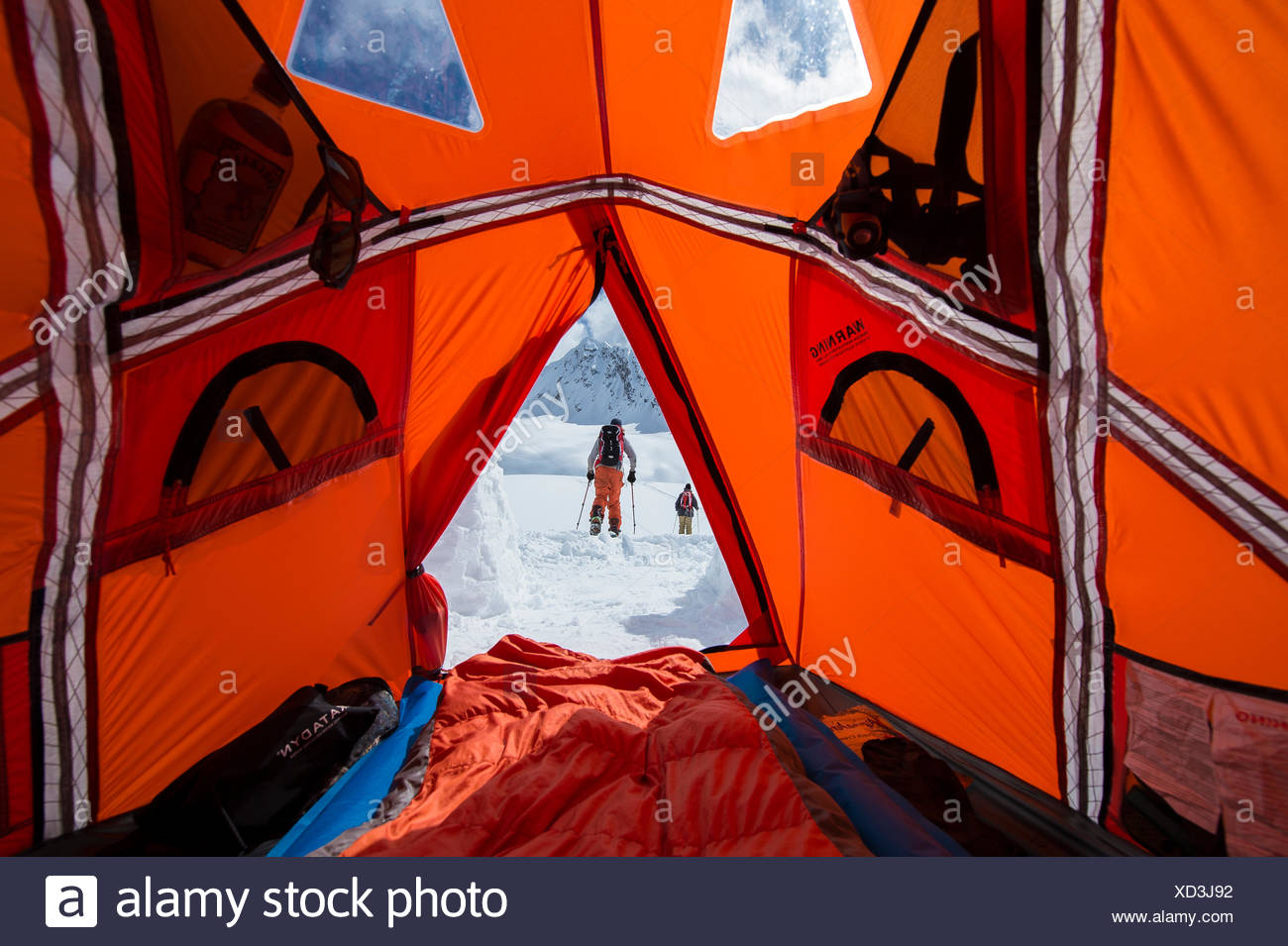 Snowboarders touring out of base camp in Canada - Stock Image