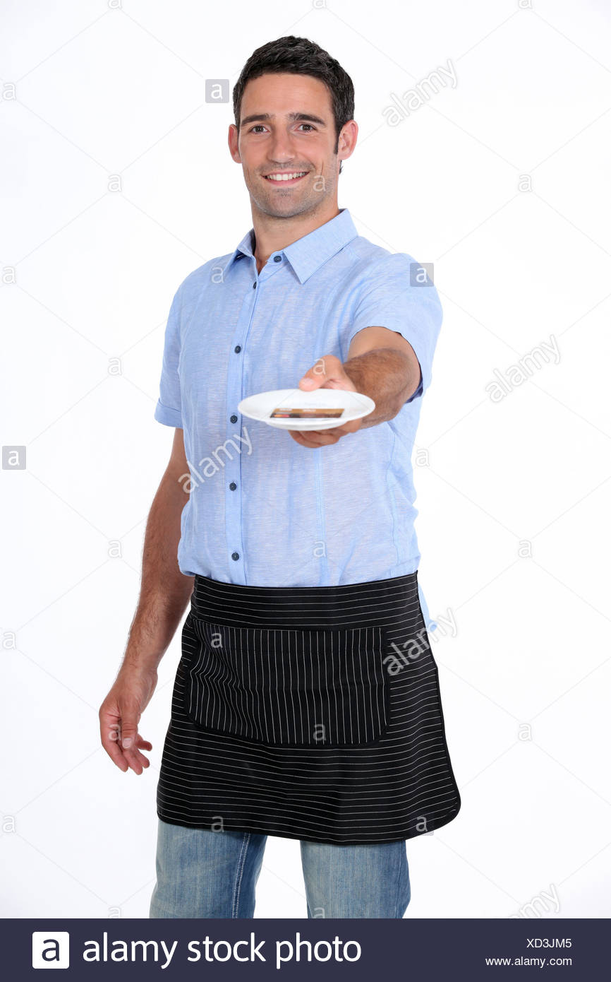man holding out saucer - Stock Image