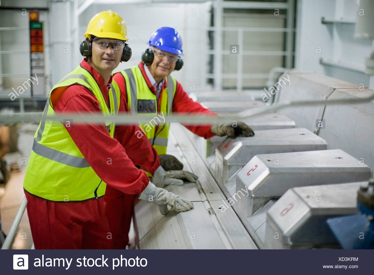 Workers doing the maintenance of a ship - Stock Image