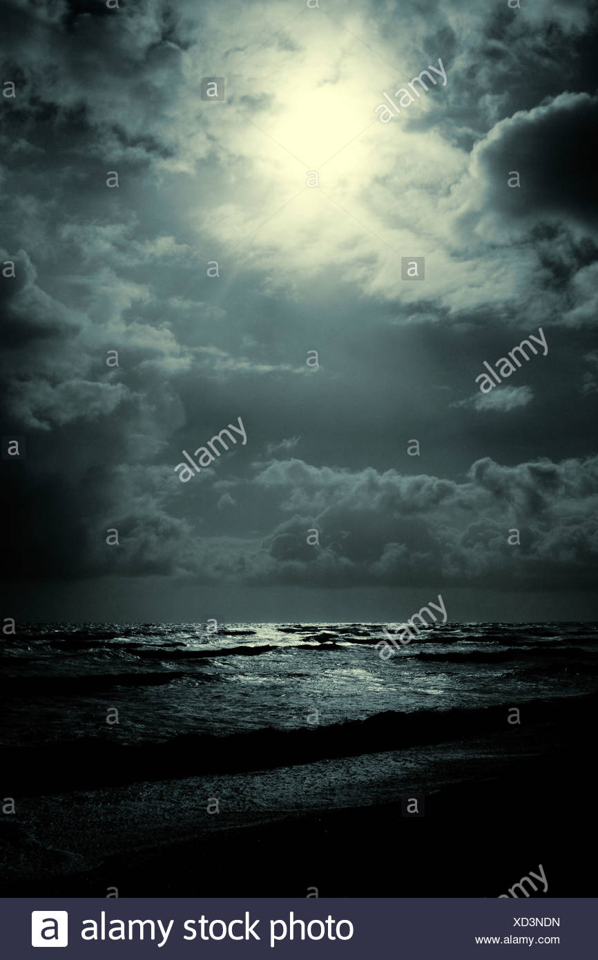 Moody apmospheric shot of the sea at night - Stock Image