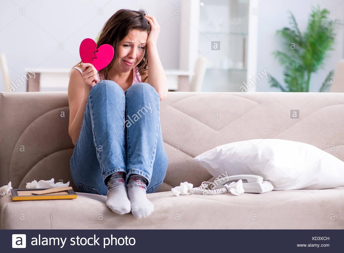 Broken woman heart in relationship concept - Stock Image