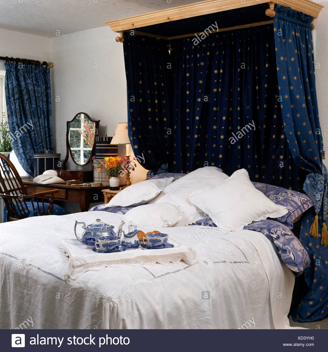 Blue Drapes On Half Tester Bed With White Cotton Victorian Bedspread