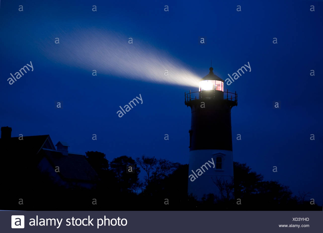 Nauset Light shines during a stormy night Cape Cod National Seashore, Eastham, Cape Cod, USA - Stock Image