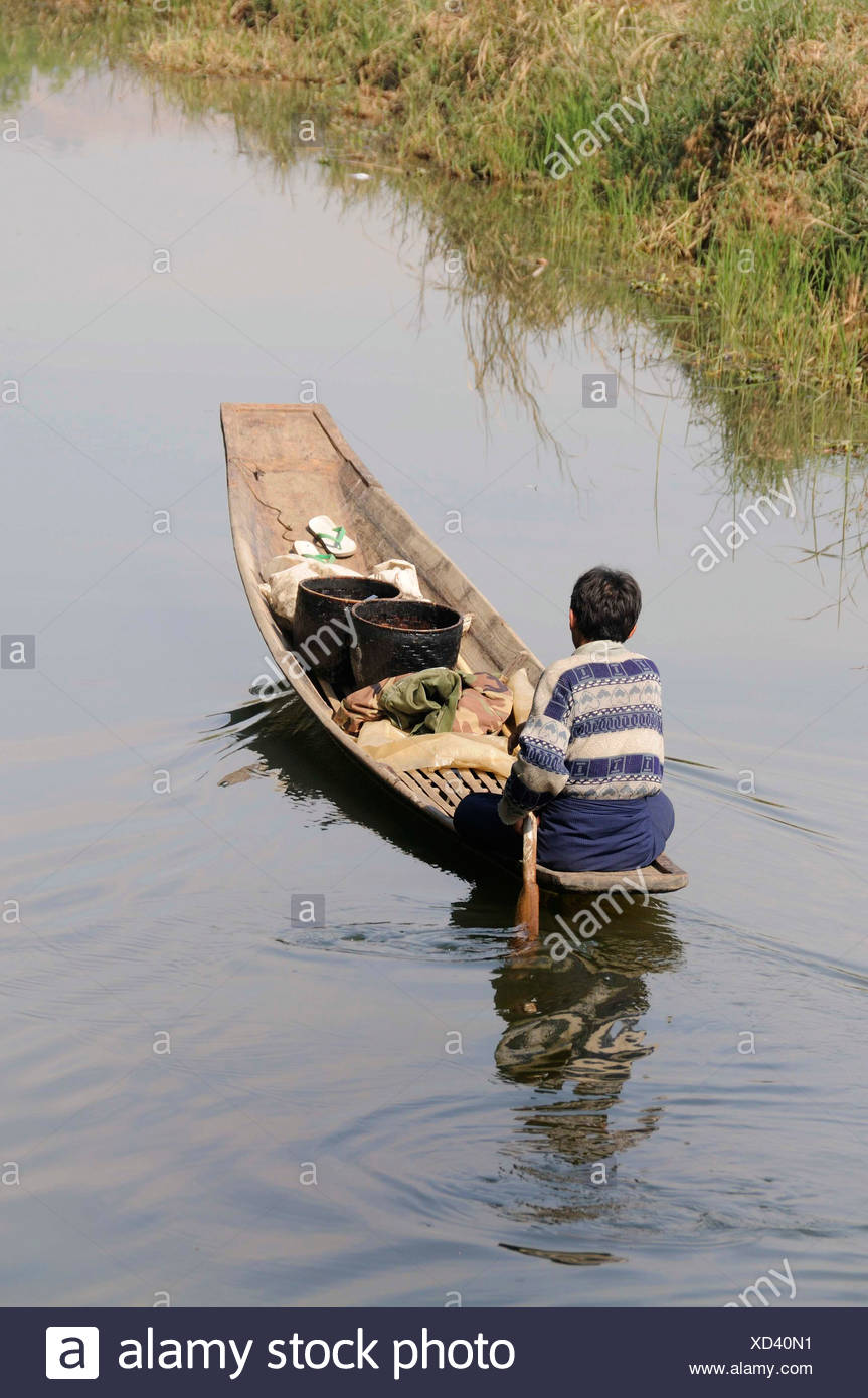 Intha boat on one of the secondary channels, Nyaung Shwe, Inle Lake, Shan State, Myanmar, Burma, Southeast Asia - Stock Image