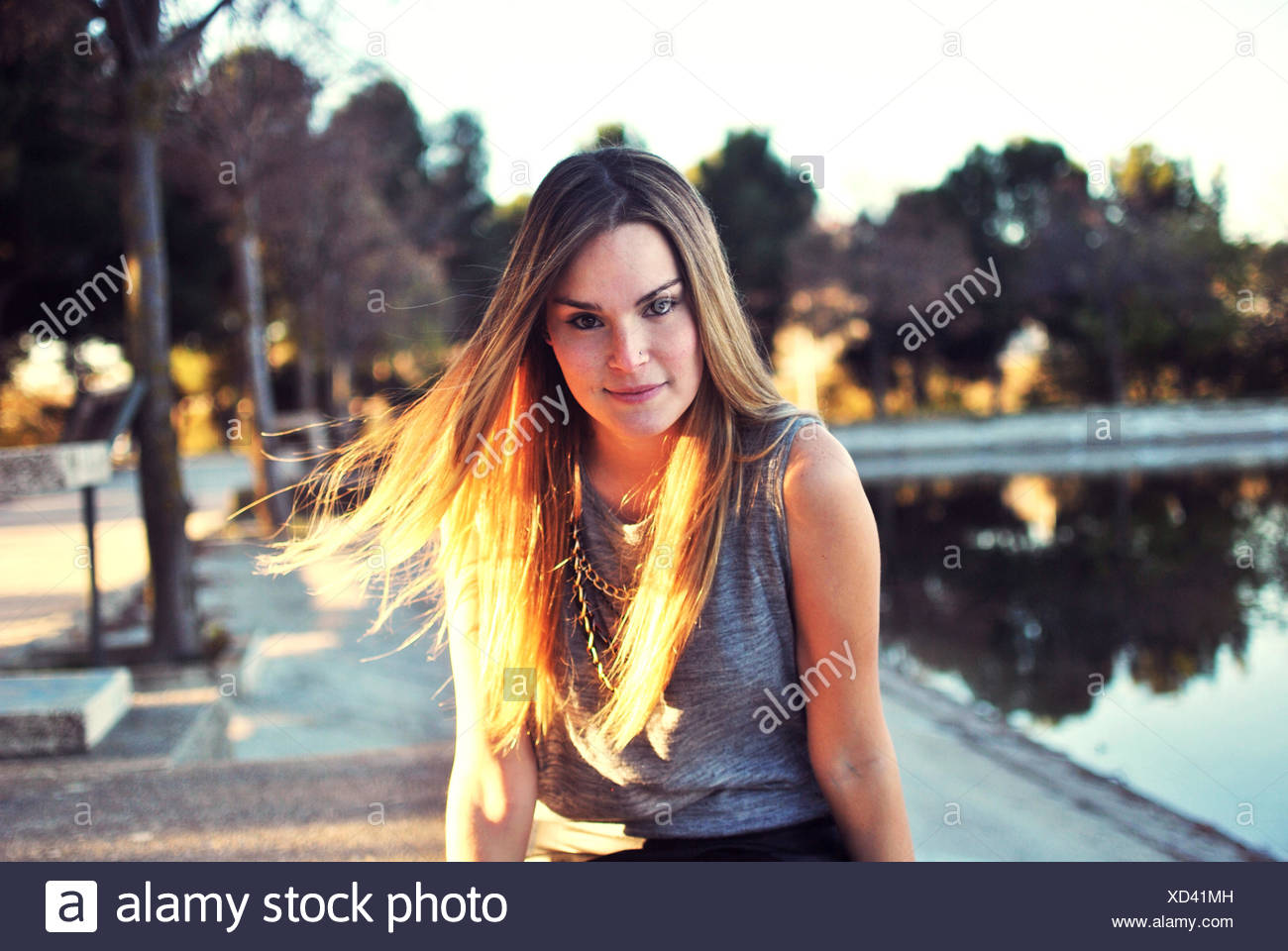 Portrait of young woman outdoors - Stock Image