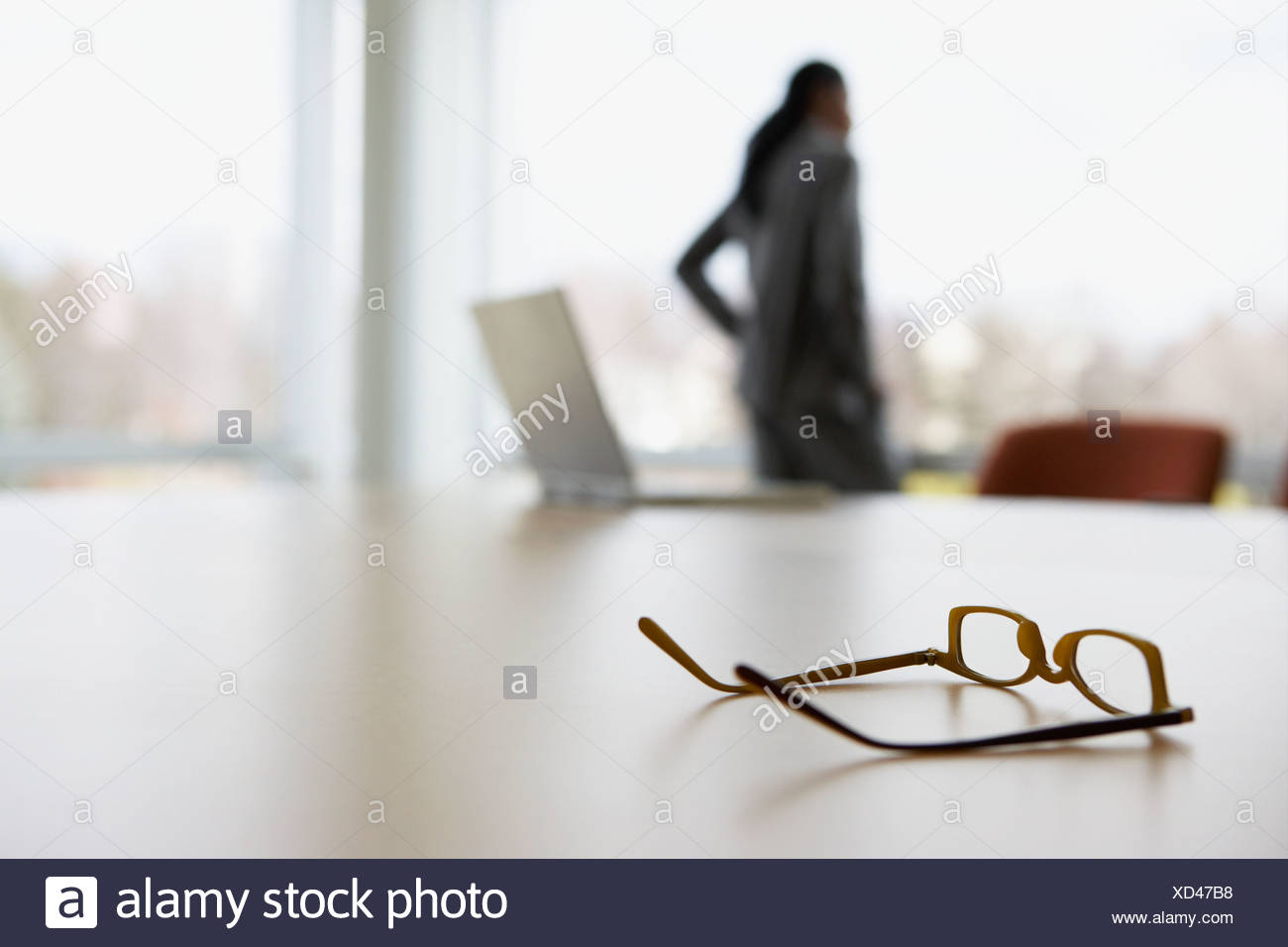 Businesswoman standing in an office - Stock Image