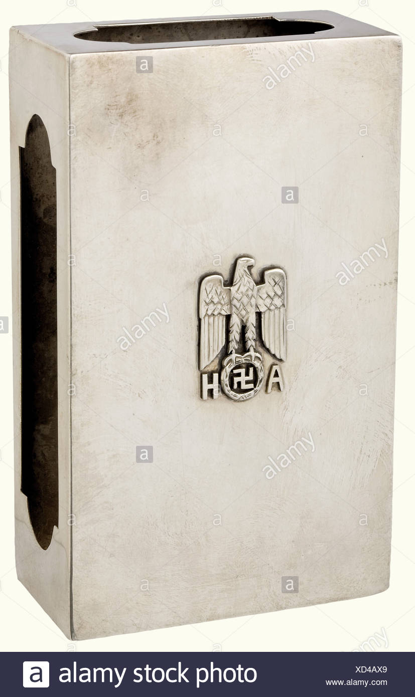 Adolf Hitler - a match case., Silver with cutouts on the sides for the striking surfaces. Superimposed national eagle and the monogram 'AH' on the top. Hallmark '800'. Weight 126 grams. 12 x 7 x 3.5 cm.' historic, historical, 1930s, 1930s, 20th century, NS, National Socialism, Nazism, Third Reich, German Reich, Germany, German, National Socialist, Nazi, Nazi period, fascism, object, objects, stills, clipping, clippings, cut out, cut-out, cut-outs, fine arts, art, art object, art objects, artful, precious, collectible, collector's item, collectibles, collector's, Additional-Rights-Clearances-NA - Stock Image