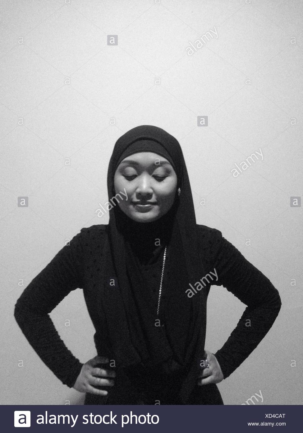 Studio Portrait Of Woman Wearing Black Hijab - Stock Image