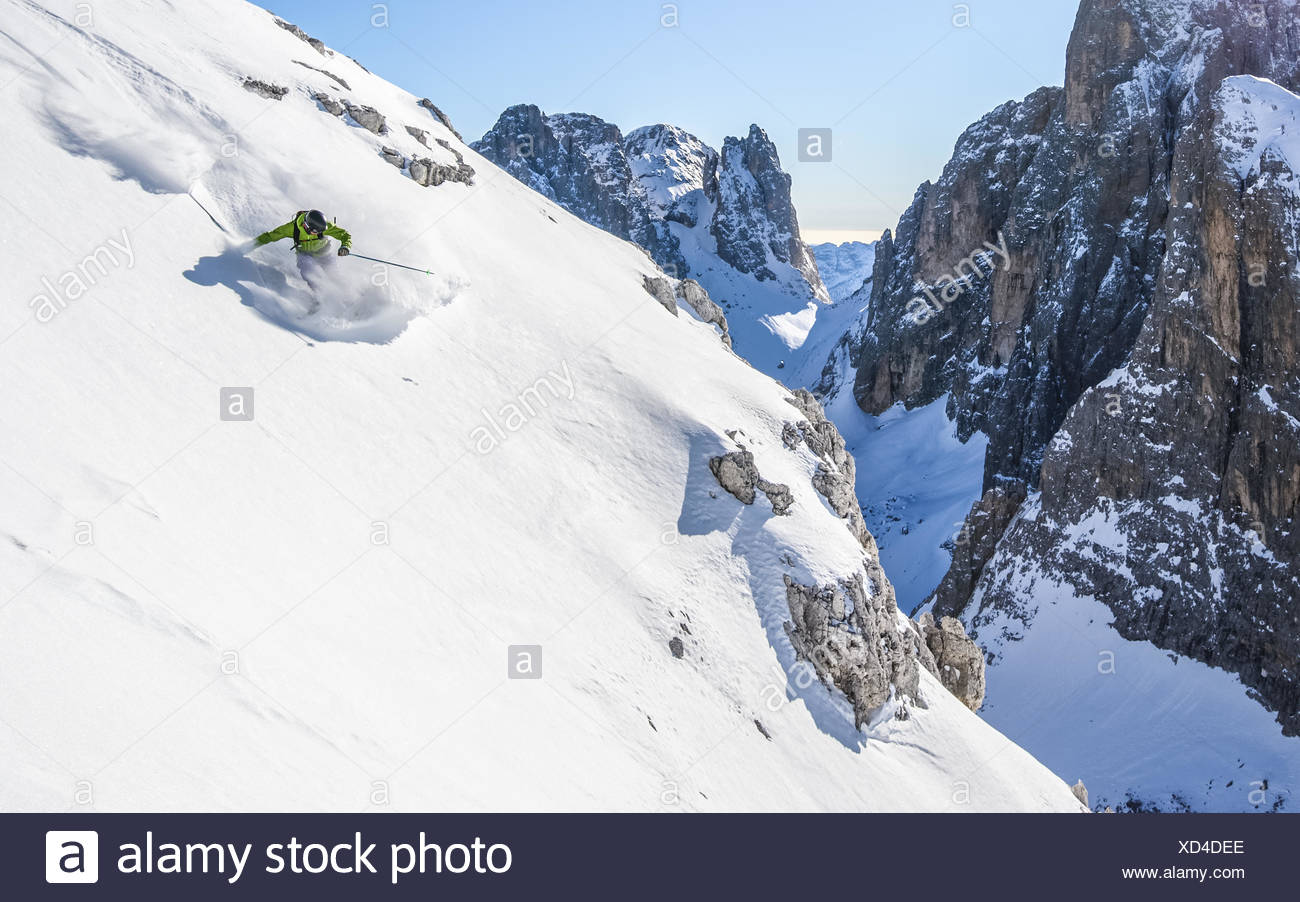 Man skiing off piste, Dolomites, Italy Stock Photo