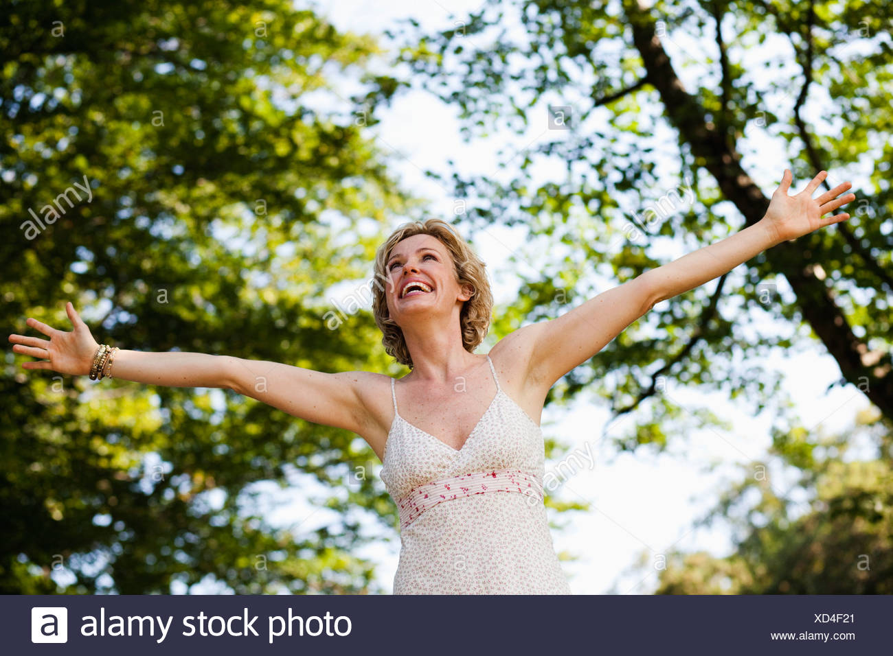 woman with arms wide open Stock Photo