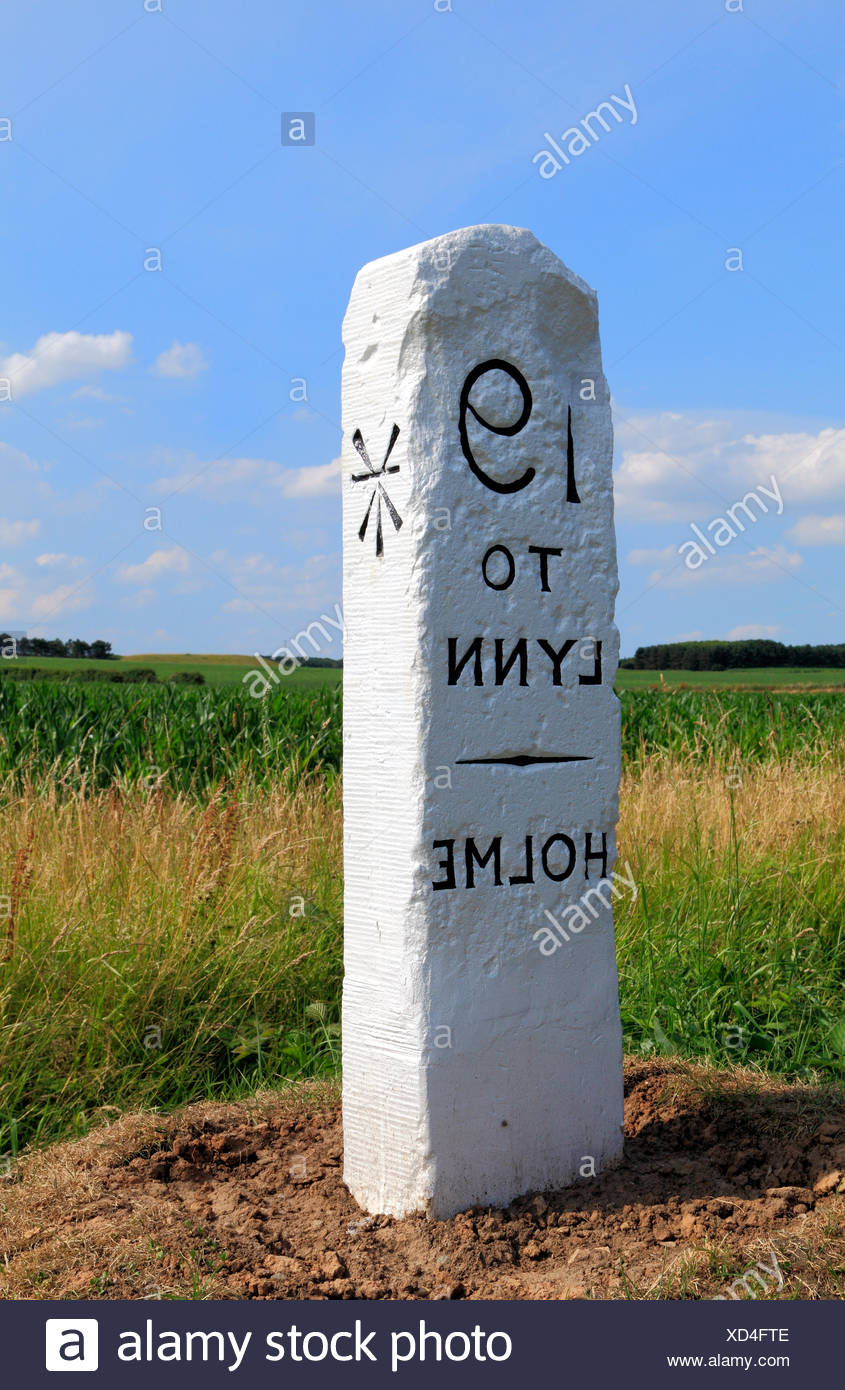 Old Milestone, Holme, Norfolk, 19 miles to Kings Lynn, broad arrow mark milestones marker markers roadside England UK - Stock Image