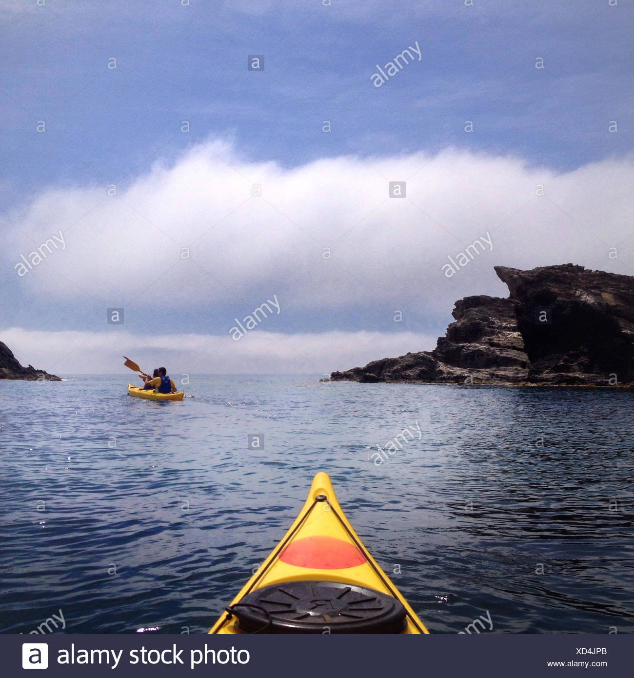 Spain, Costa Brava, Kayaking among cliffs Stock Photo