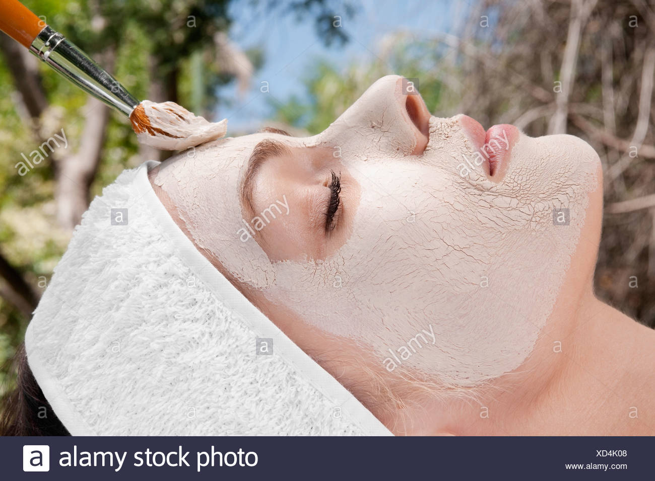 Woman applying face pack - Stock Image