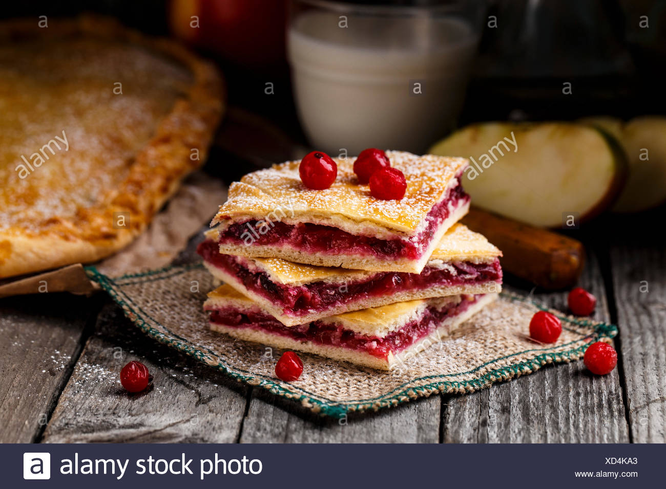 Delicious homemade pie stuffed with cranberries and apple - Stock Image
