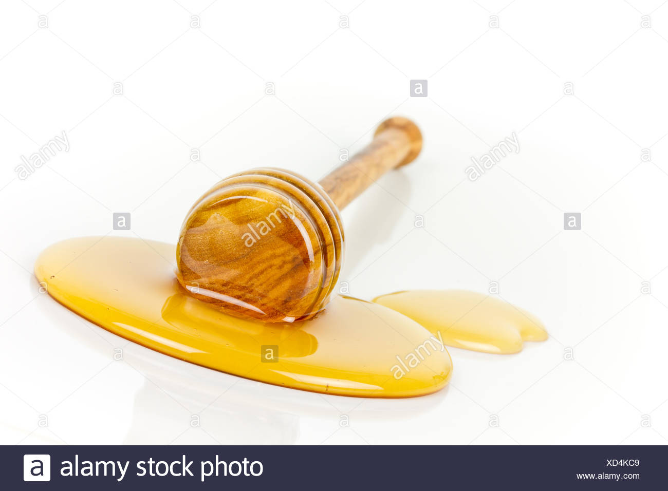 honey with honey dipper - Stock Image
