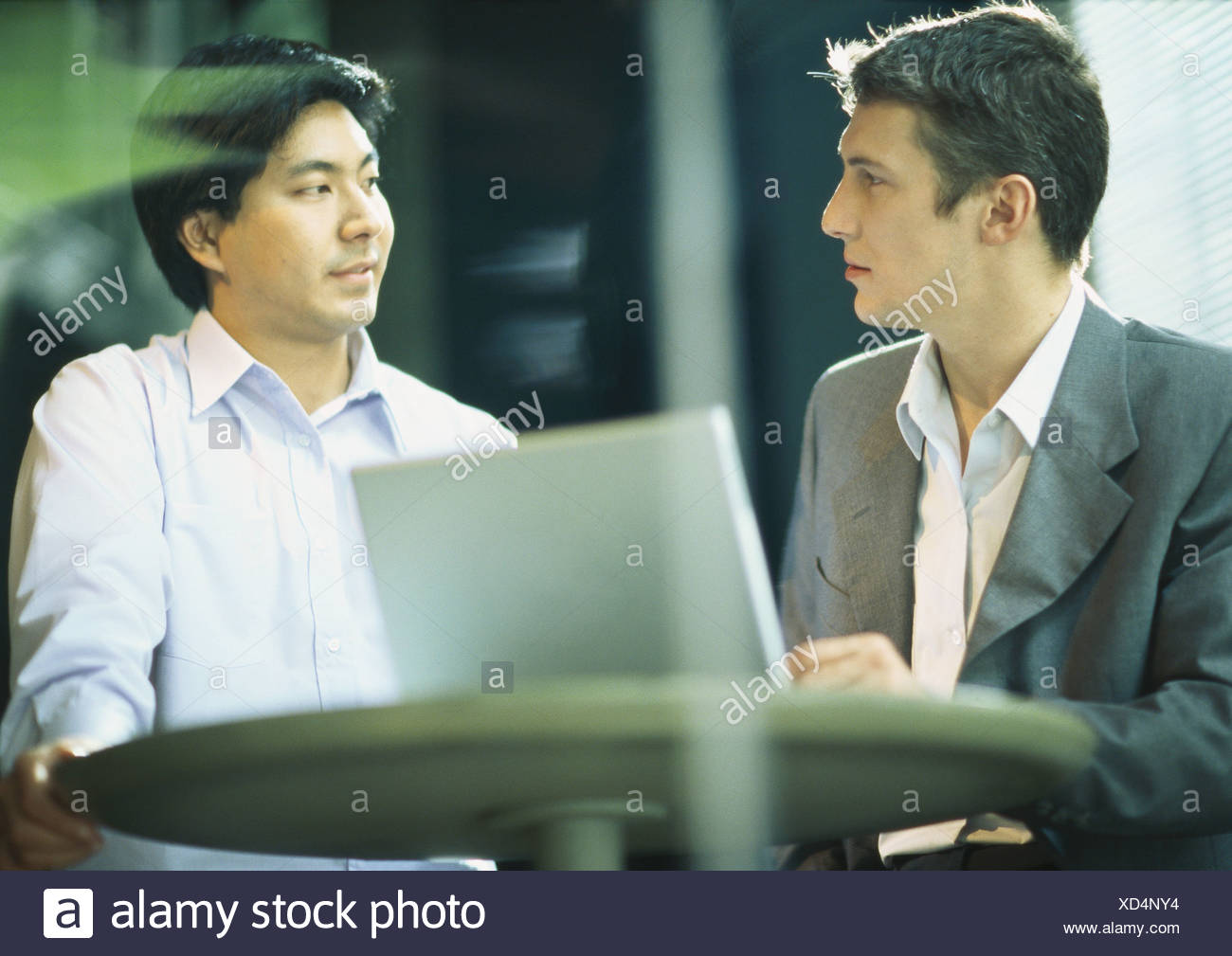 Two businessman staring at each other - Stock Image