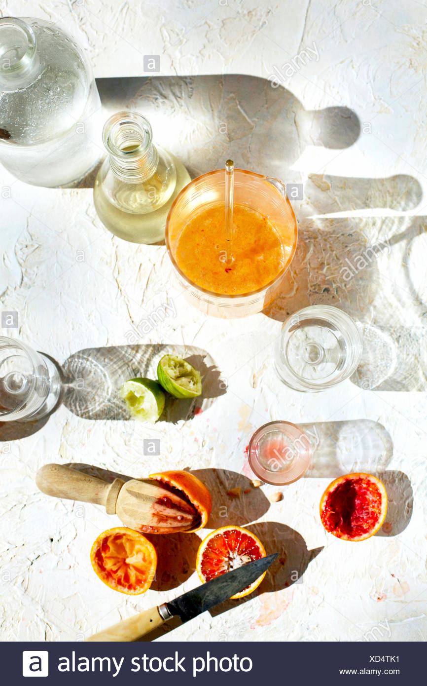 Blood Orange Lime Spritzer. Photographed on a white plaster background. Stock Photo