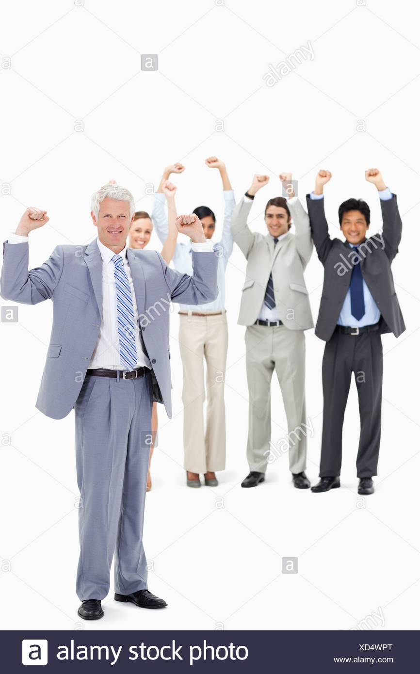 Enthusiast multicultural business team raising their arms with a mature man - Stock Image