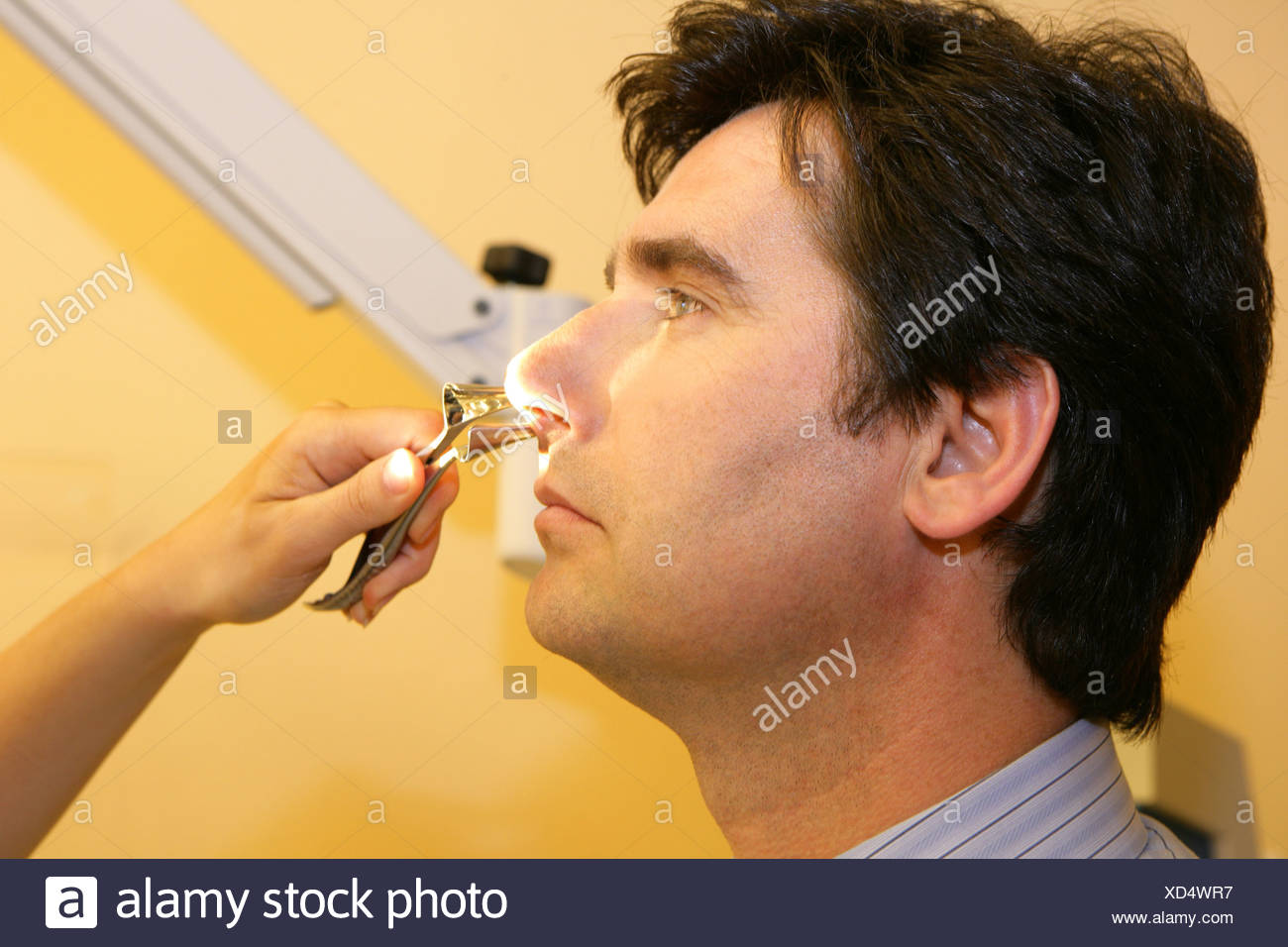 ENT physician man examination - Stock Image