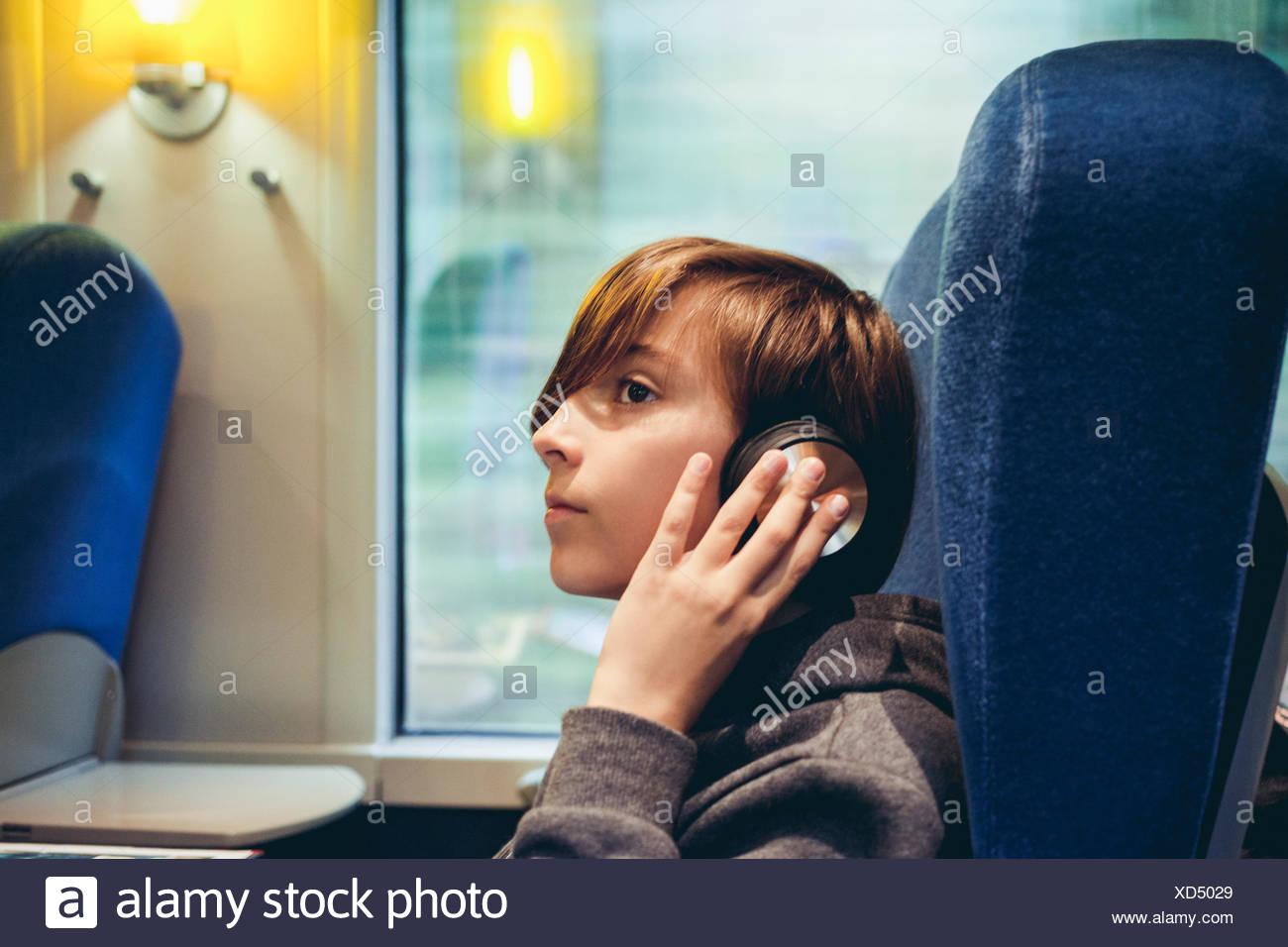 Boy listening to music - Stock Image