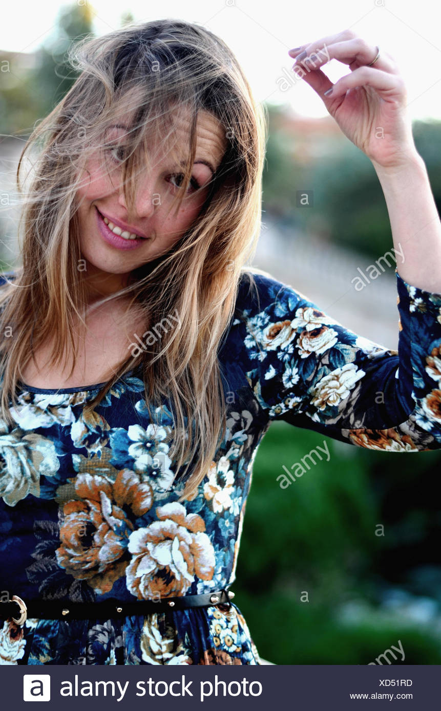 Portrait of a woman with windswept hair - Stock Image