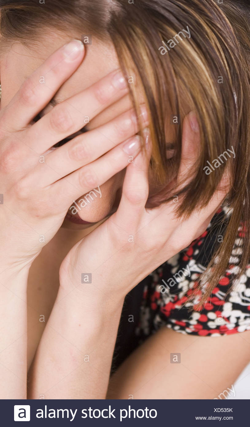 Hands hiding face - Stock Image