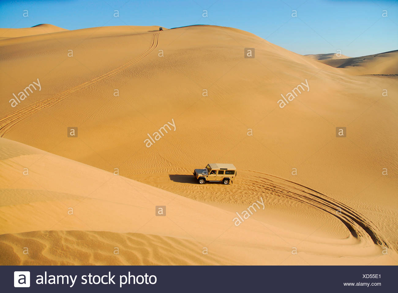 Jeeps in the dunes near Conception Bay, restricted diamond area, Namibia, Africa - Stock Image