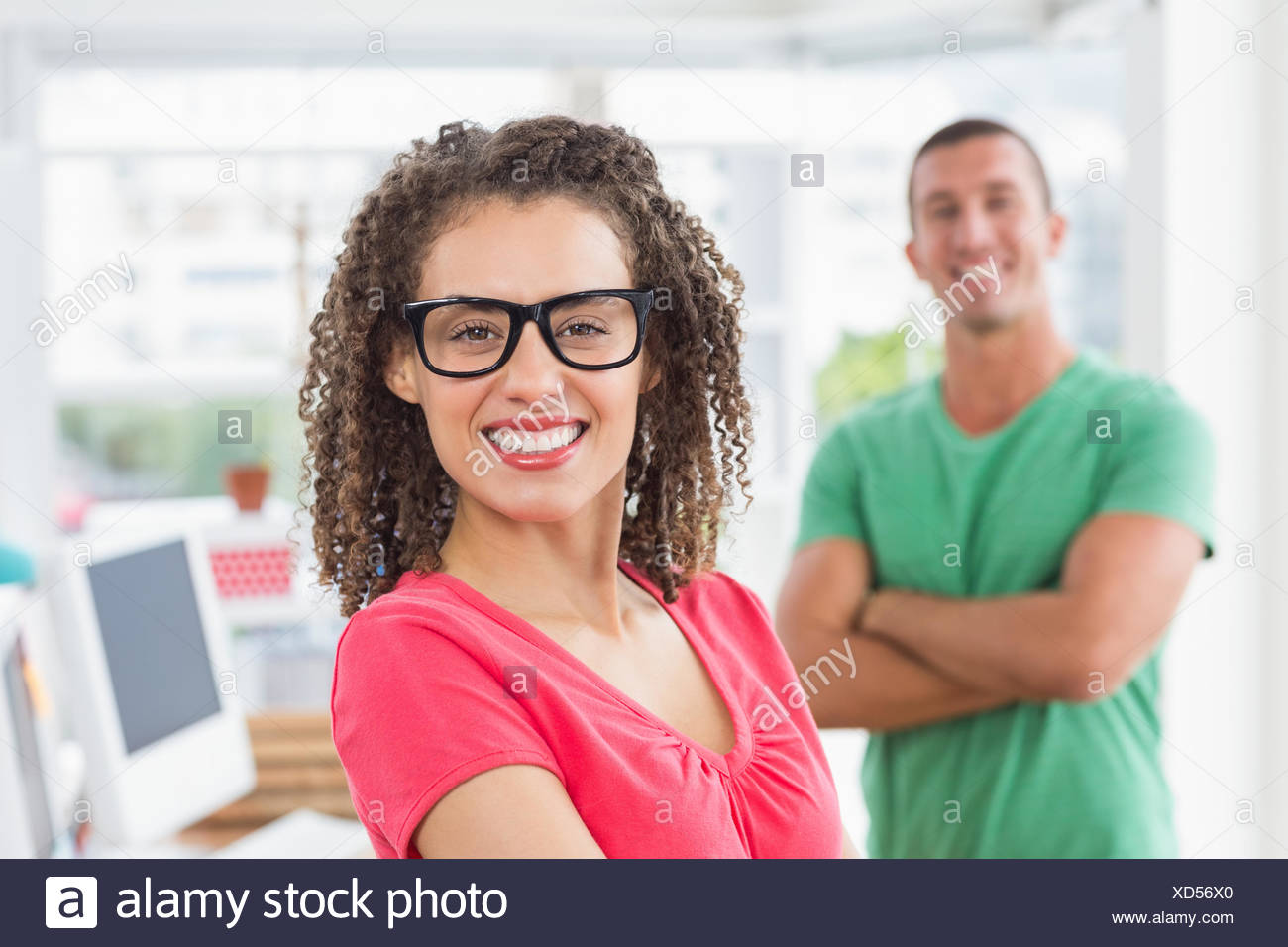 Closeup of a casual female artist with colleague at office Stock Photo