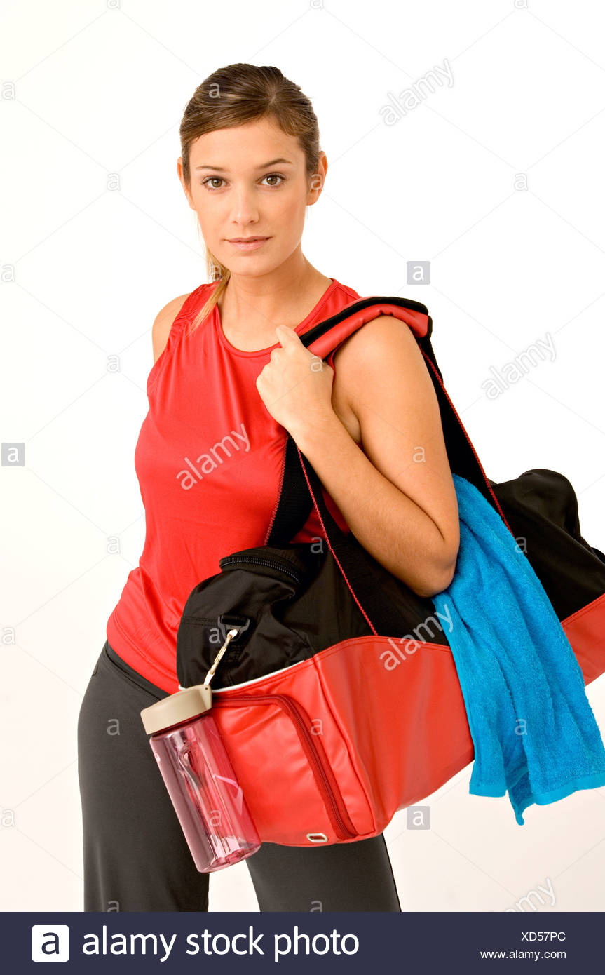 e53c34ee Portrait of a young woman carrying a gym bag Stock Photo: 283472292 ...