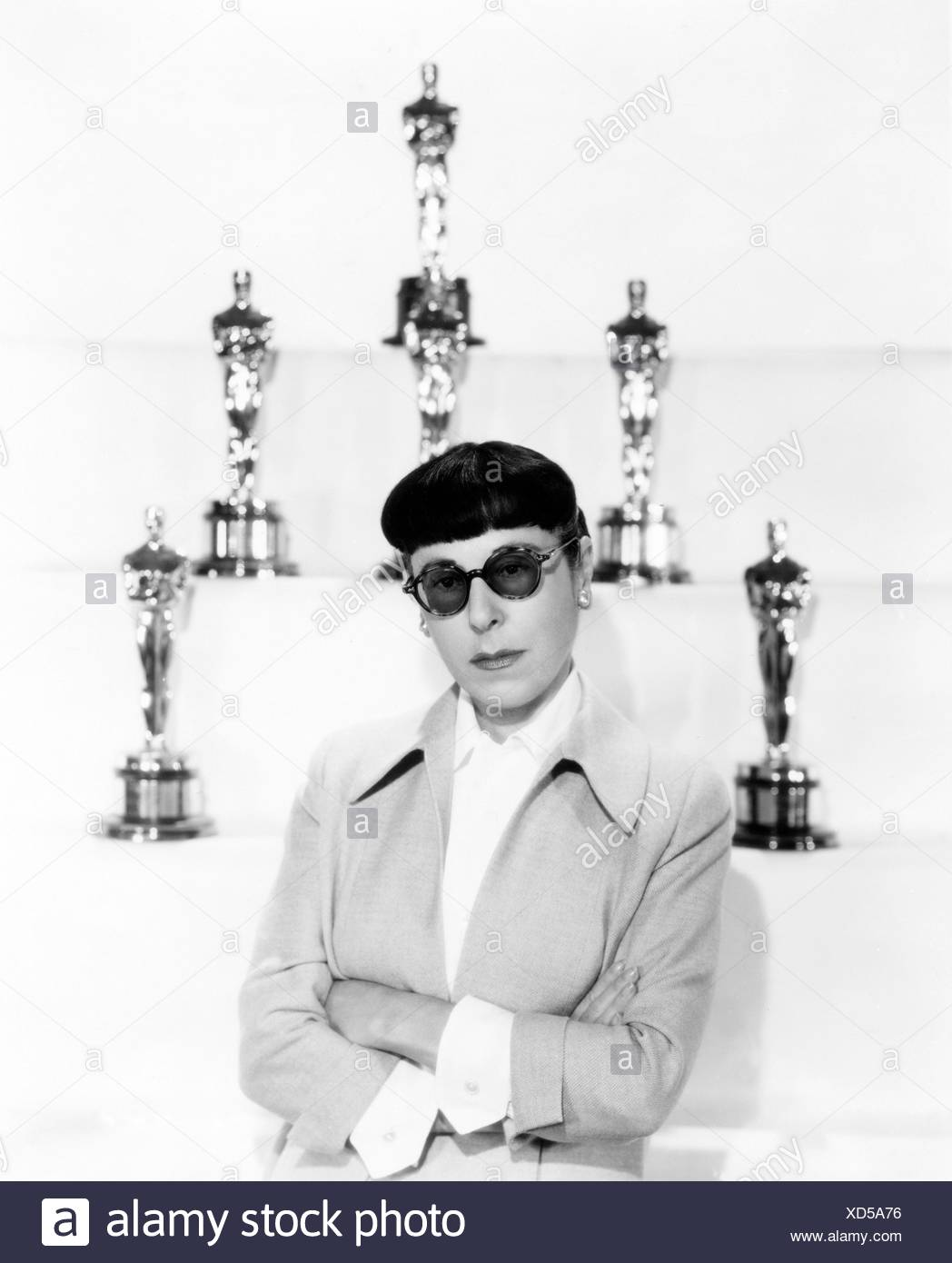 Edith Head (1897-1981), costume designer, who won a record eight Oscar for Best Costume Design. 1957 (Paramount Pictures) - Stock Image