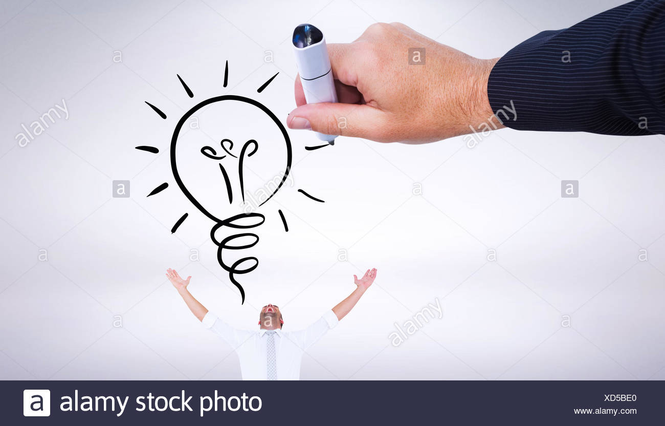 Composite image of hand drawing light bulb - Stock Image