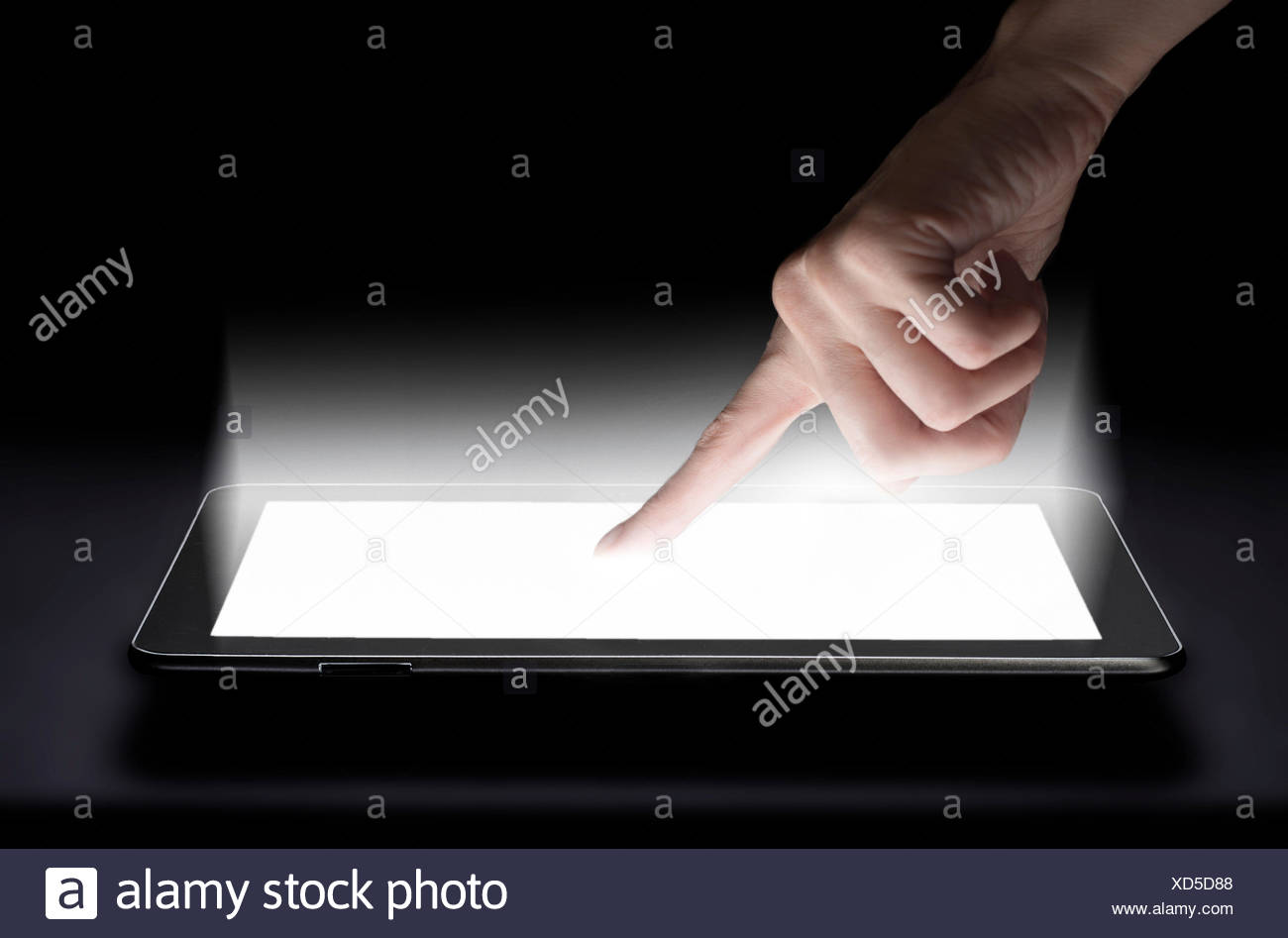 Woman touching digital tablet in studio - Stock Image