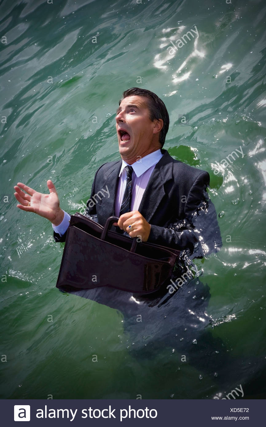 Businessman drowning in water - Stock Image