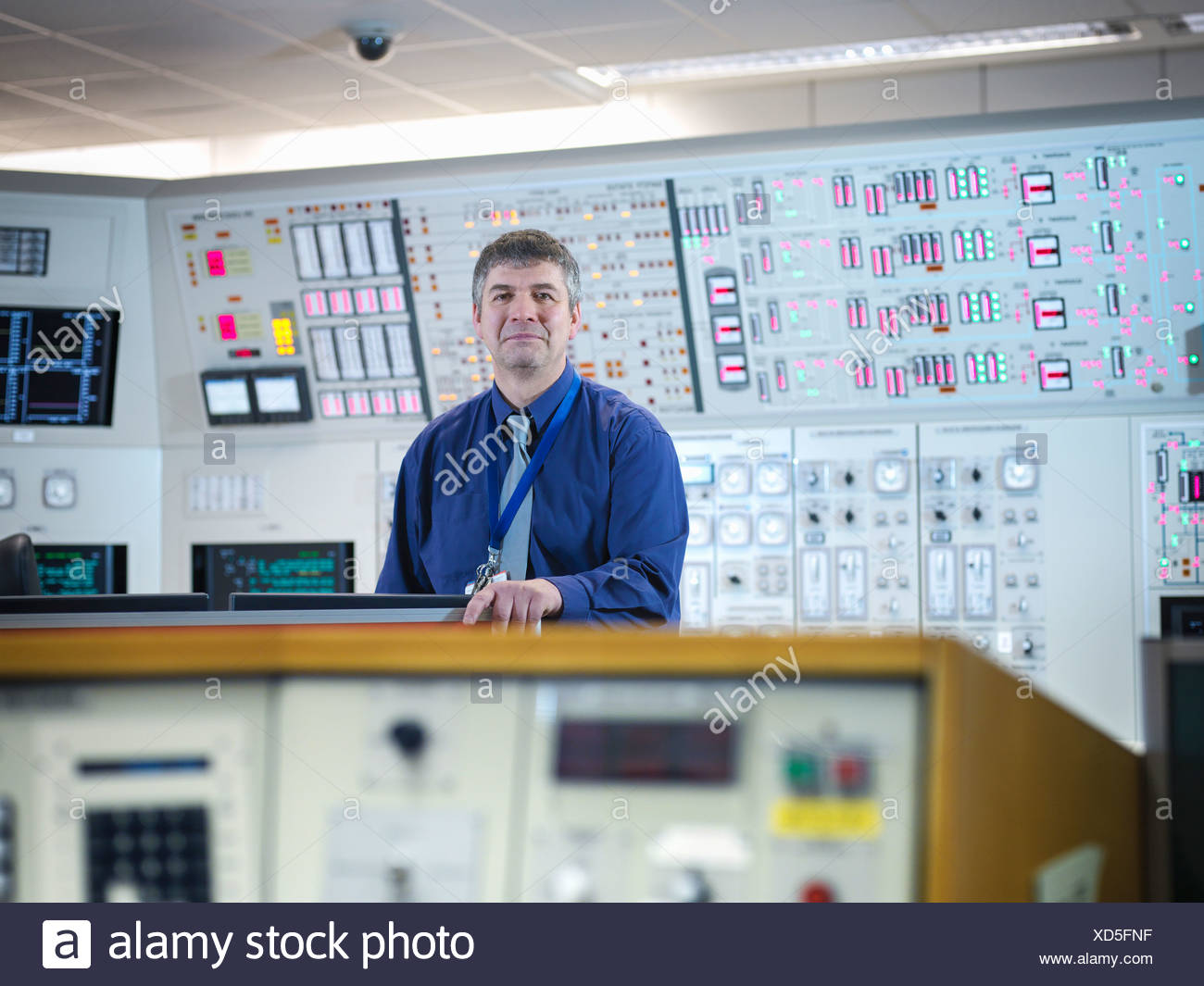 Portrait of operator in nuclear power station control room simulator - Stock Image