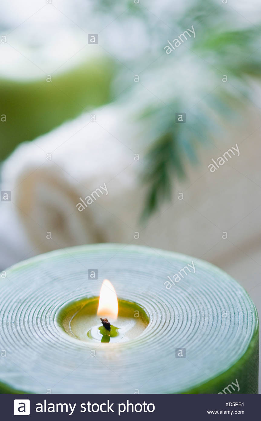 Close-up of an aromatherapy candle burning - Stock Image